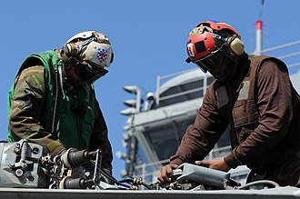 Aviation structural mechanic - Aviation structural mechanics perform routine maintenance on an MH-60S Sea Hawk helicopter