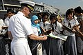 US Navy 090220-N-3830J-045 Capt. Thom W. Burke, commanding officer of the amphibious command ship USS Blue Ridge (LCC 19), gives books to students of the Taguig National High School as part of a Project Handclasp donation.jpg