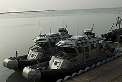 US Navy 090517-N-9286M-003 Iraqi Navy defender-class patrol boats are moored to a pier at Umm Qasr, south port terminal in Basra, Iraq.jpg