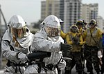 US Navy 090630-N-9520G-021 Sailors assigned to the air department crash and salvage team of the amphibious assault ship USS Essex (LHD 2) fight a simulated class bravo fire on the flight deck of the ship.jpg