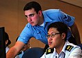 US Navy 090813-N-5207L-087 Information Systems Technician assigned to Command Logistics Group Western Pacific, works with Republic of Singapore Navy Capt.jpg
