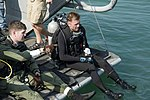 US Navy 100120-N-1134L-144 Staff Sgt. Stephen Key and Sgt. Randy Mackey prepare to conduct underwater pier inspections in Port-au-Prince.jpg