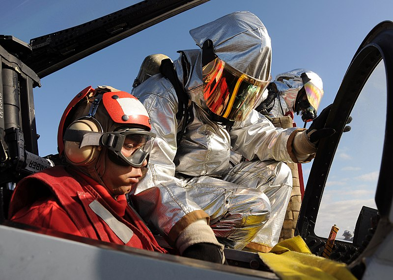 File:US Navy 100403-N-3885H-092 Members of the air department crash and salvage team aboard the aircraft carrier USS George H.W. Bush (CVN 77) practice rescuing a pilot during a drill on the flight deck.jpg