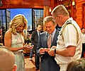 US Navy 100524-N-7863V-001 Capt. Mark Genung presents Regis Philbin and Kelly Ripa with command coins during a taping of the Regis ^ Kelly Show.jpg