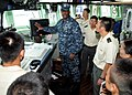 US Navy 100812-N-8113T-086 Lt. Bobby Jone describes the duties and responsibilities of the bridge watch team from the pilot house to a group of Japan Ground Self-Defense Force soldiers.jpg