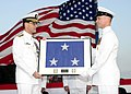 US Navy 100910-N-5086M-261 Command Master Chief Tyler Schoeppey, right, presents the vice admiral's flag to Vice Adm. John M. Bird, the outgoing co.jpg