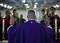 US Navy 101205-N-7981E-127 Cmdr. Keith Shuley, command chaplain of the aircraft carrier USS Carl Vinson (CVN 70), leads Sailors in prayer during Ro.jpg