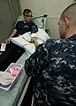 US Navy 101205-N-9626Y-036 Aviation Ordnanceman Airman Amanda Longie, from Busey, Mont., donates blood aboard the aircraft carrier USS George Wash.jpg