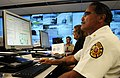 US Navy 110223-N-WP746-003 Wallace Mason, assistant chief of the Commander, Navy Region Hawaii Federal Fire Department, monitors a Solid Curtain-Ci.jpg
