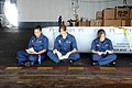 US Navy 110705-N-AU622-004 Midshipmen take a few minutes during their lunch break to read in the hangar bay of the aircraft carrier USS Dwight D. E.jpg