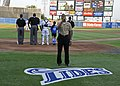 US Navy 110709-N-GC639-072 Aviation Electronics Technician 1st Class Courtney Parker sings the national anthem before the Norfolk Tides baseball ga.jpg