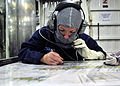 US Navy 110913-N-ZF681-232 Chief (Select) Boatswain's Mate Kimberly Ford plots the location of a fire during a damage control exercise aboard the g.jpg