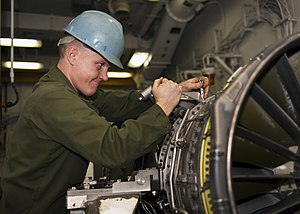 US Navy 120118-N-FI736-115 Cpl. William Gillespie, assigned to the Thunderbolts of Marine Fighter Attack Squadron (VMFA) 251, removes test gear fro.jpg