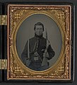 Unidentified soldier in Union uniform with cavalry saber, single shot pistol carbine, and Colt Navy revolver LCCN2011648535.jpg