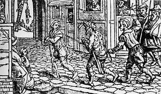 Vagrancy - A woodcut from c. 1536 depicting a vagrant being punished in the streets in Tudor England.