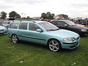 Passenger side view of a seafoam green pre-facelift V70 R