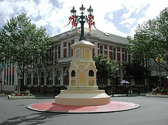 Whanganui - The Watt Fountain in Victoria Avenue. The former Post Office building is in the background.