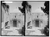 Weli of Budrieh at Sherafat and the preparing of a sacrifice. Ornamented entrance to the tomb. LOC matpc.01414.jpg