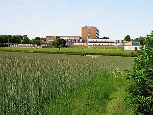 Vision West Nottinghamshire College - The Derby Road Campus in 2005, showing adjacent farmland in the foreground, with Derby Road running directly alongside at the rear of the building