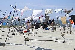 Woman Hanging Laundry - Alfuraba Fishing Village - Porto, Portugal (4642943312).jpg