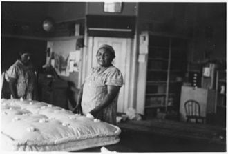 Federal Emergency Relief Administration - Ojibwe women stuffing mattresses, c. 1935
