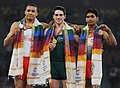 XIX Commonwealth Games-2010 Delhi Thomas Pichler of Australia (Gold), Reiss Beckford of England (Silver) and Ashish Kumar of India (Bronze) during the medal presentation ceremony of the men's floor exercise of Commonwealth.jpg