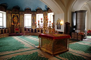 Bishop (Eastern Orthodox Church) - Sanctuary of the Holy Transfiguration Cathedral, Valaam Monastery, Russia: the Antimension is open on the Holy Table (altar) for the bishop's visit; at the rear is the Kathedra (bishop's throne)
