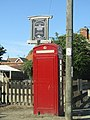 -2018-08-05 Red telephone box and Pub sign, Northrepps.JPG
