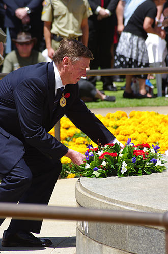 Remembrance Day - The Governor of Western Australia, Malcolm McCusker, laying a wreath at the Eternal flame, Kings Park, Western Australia, 11 November 2011