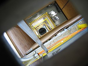 Drop tube - A view down the shaft of NASA Glenn's 2.2 second drop tower. A large (deflated) air bag is at the bottom.