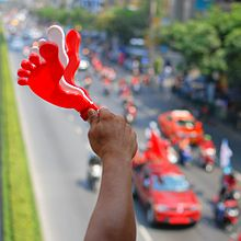 red clapper in the form of a foot