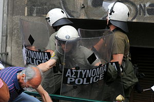 Anti-austerity movement in Greece - Clash between riot police and a citizen – 29 June 2011.