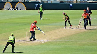 2015–16 Women's Big Bash League season - Lauren Cheatle of Sydney Thunder bowls to Elyse Villani of Perth Scorchers during the Scorchers v Thunder match at the WACA Ground, Perth, on 28 December 2015.  The other batter is Charlotte Edwards, and the wicket-keeper is Claire Koski.