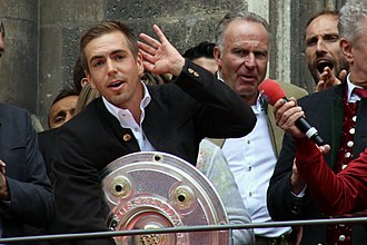 Philipp Lahm - Lahm holding the Meisterschale during the Championship title celebration in May 2016