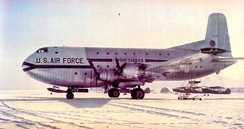 A large four-engined transport aircraft sitting on the ground