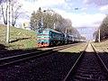2M62-0397 with train, Khmelnytskyi, Khmel'nyts'ka oblast, Ukraine.jpg