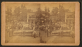 4th of July (1896) celebration in Marengo showing clowns with cannon, simple ferris wheel, by S. L. Platt.png
