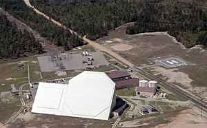 Eglin AFB Site C-6 - Aerial view of radar, showing transmitter building (white) with square transmitting array (left) and octagonal receiving array (right)