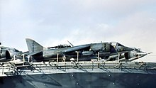 several Harriers stored on board a ship