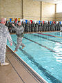 A U.S. Army officer candidate from Bravo Company, 3rd Battailon, 11th Infantry Regiment prepares to enter a swimming pool during the combat water survival portion of Officer Candidate School March 14, 2008 080314-A-XR214-028.jpg