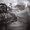 """A WORKER AT THE """"ASSIS"""" FRUIT JUICE BOTTLING PLANT IN RAMAT GAN. תעשייה. בצילום, פועלת במפעל """"עסיס"""" לייצור בקבוקי מיץ פירות ברמת גן.D834-045.jpg"""