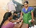 A female voter being administered indelible ink, at a polling booth, during the 8th Phase of General Elections-2014, at Madhavadhara, in Visakhapatnam, Andhra Pradesh on May 07, 2014.jpg