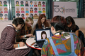 A group of women around a table at the BBC 100WomenWiki editathon.png