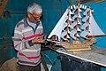 A man making a sailboat2.jpg