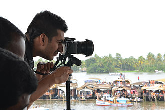 Nehru Trophy Boat Race - A tourist capturing the race moments. Nehru Trophy Boat Race 2013