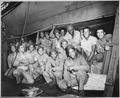 Aboard a U.S. Coast Guard-manned transport somewhere in the Pacific, a group of Negro Marines presents a cheerful front. - NARA - 513198.tif