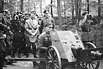 Adolf Hitler reviewing artillery ca. 1940.jpg