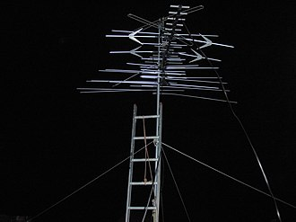 Television antenna - A Winegard 68 element VHF/UHF aerial antenna. This common multi-band antenna type uses a UHF yagi at the front and a VHF log-periodic at the back coupled together.