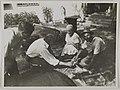 Akseli Gallen-Kallela with workers at Tarvaspää repairing the building, ca.1927; photograph 2. (14542246839).jpg