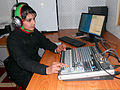 An Afghan Uniformed Police broadcaster with the 303rd Pamir Division monitors the levels on a song inside the new police radio station in Mazar-e-Sharif, Afghanistan, Feb 120215-N-CB888-001.jpg